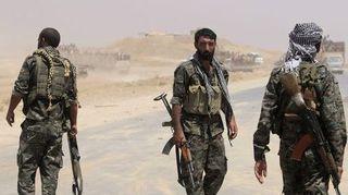 4501410_3_b7ab_des-combattants-kurdes-du-parti-pyd-en-syrie_e65a0421e69aae5b705d5c0d43e65e5e