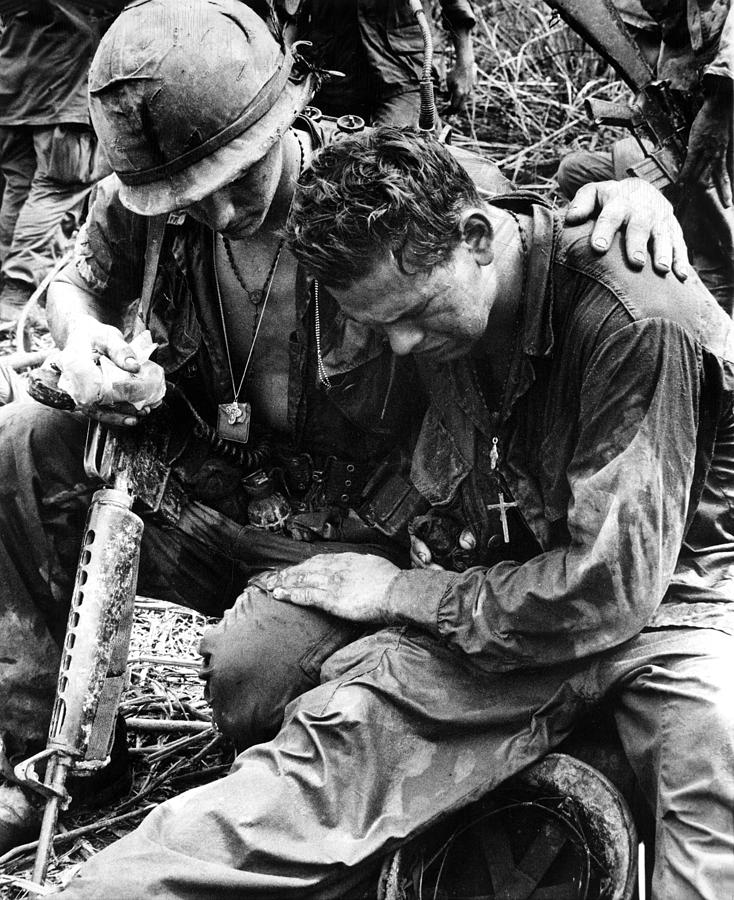Two soldiers comfort each other
