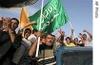 Ap_jubilant_iraqis_carry_a_flag_of_iraq_